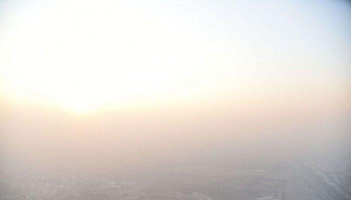 تصاویر دیدنی روز؛ از غروب آفتاب در هوای آلوده تا جشن لوهری